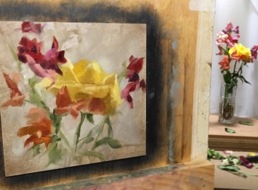 A fiery painting in the works. Yellow rose with Snapdragons.